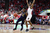 RALEIGH, NC - JANUARY 9: T.J. Gibbs #10 of the University of Notre Dame drives past Markell Johnson #11 of North Carolina State University during a game between Notre Dame and NC State at PNC Arena on January 9, 2020 in Raleigh, North Carolina.
