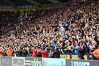 Sunday, 26 April 2014<br /> Pictured: Swansea supporters celebrating their win after the final whistle.<br /> Re: Barclay's Premier League, Swansea City FC v Aston Villa at the Liberty Stadium, south Wales.