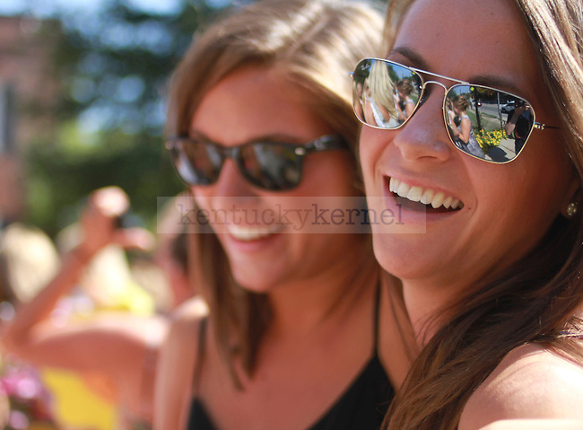 Two Alpha Delta Pi sorority pledges smile and chat at their sorority house to celebrate bid day on August 20, 2010.