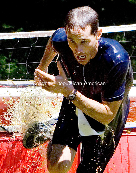TORRINGTON, CT. 30 June 2012-063012SV06-Eric Koestner makes his way out of the cold splash pool during the WYLD Mud Run 5K at John Minetto State Park in Torrington Saturday. Over 500 participants ran the race sponsored by the Northwest Torrington YMCA..Steven Valenti Republican-American