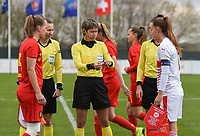 20190403  - Tubize , BELGIUM : referee Elvira Nurmustafina (M) with captain Ella Vierendeels (L) and captain Malin Gut (R) pictured during the soccer match between the women under 19 teams of Belgium and Switzerland , on the first matchday in group 2 of the UEFA Women Under19 Elite rounds in Tubize , Belgium. Wednesday 3 th April 2019 . PHOTO DIRK VUYLSTEKE / Sportpix.be