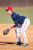 Shippensburg Raiders first baseman Dalton Hoiles (32) on defense against the Belmont Abbey Crusaders at Abbey Yard on February 8, 2015 in Belmont, North Carolina.  The Raiders defeated the Crusaders 14-0.  (Brian Westerholt/Four Seam Images)