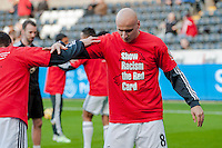 Saturday 29th November 2014<br /> Pictured: Swansea City Players train with ' Show racism the Red Card '  T-shitrs on before the match <br /> Re: Barclays Premier League Swansea City v Crystal Palace at the Liberty Stadium, Swansea, Wales,UK