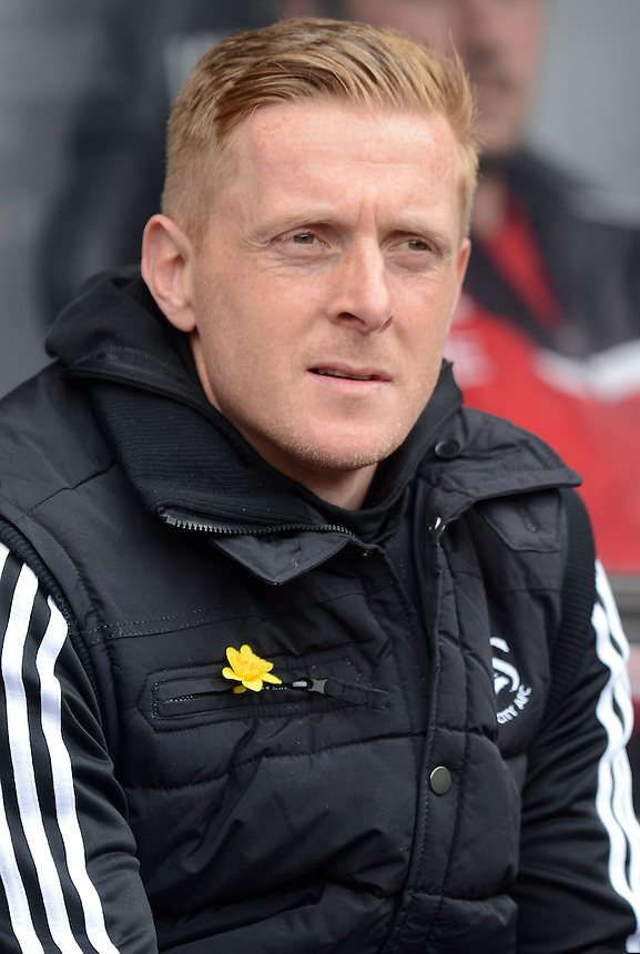 Swansea City's Head Coach Garry Monk prior to kick off <br /> <br /> Photo by Ian Cook/CameraSport<br /> <br /> Football - Barclays Premiership - Swansea City v Norwich City - Saturday 29th March 2014 - The Liberty Stadium - Swansea<br /> <br /> &copy; CameraSport - 43 Linden Ave. Countesthorpe. Leicester. England. LE8 5PG - Tel: +44 (0) 116 277 4147 - admin@camerasport.com - www.camerasport.com