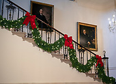 "The 2018 White House Christmas decorations, with the theme ""American Treasures"" which were personally selected by first lady Melania Trump, are previewed for the press in Washington, DC on Monday, November 26, 2018. Pictured are decorations on the Grand Staircase near the portraits of US President Harry S Truman, left, and Franklin Delano Roosevelt, right.  <br /> Credit: Ron Sachs / CNP"