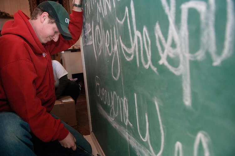 18537Students volunteering at a local church in Mineral, Ohio during MLK Day on January 21, 2008..Adam Young takes down chalk board.