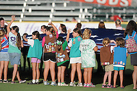 Girl Scouts unfurl a huge American flag prior to a game between the Myrtle Beach Pelicans and Frederick Keys on August 4, 2012, at TicketReturn.Com Field in Myrtle Beach, South Carolina. (Tom Priddy/Four Seam Images)