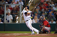 Minnesota Twins second baseman Brian Dozier (2) hits a home run in front of catcher Blake Swihart (23) during a Spring Training game against the Boston Red Sox on March 16, 2016 at Hammond Stadium in Fort Myers, Florida.  Minnesota defeated Boston 9-4.  (Mike Janes/Four Seam Images)