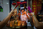 Devout Chinese light the incense sticks at the Goddess of Mercy temple in capital Georgetown of Penang, Malaysia. The Goddess of Mercy Temple or Kuan Yin Ting is the oldest Chinese temple in Penang, built in 1880s by early immigrants from China. Photo: Sanjit Das/Panos
