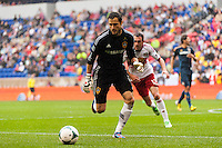 Los Angeles Galaxy goalkeeper Carlo Cudicini (1) chases down a ball during the first half against the New York Red Bulls during a Major League Soccer (MLS) match at Red Bull Arena in Harrison, NJ, on May 19, 2013.