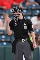 Home plate umpire Brett Terry asks for baseballs during a game between the Frisco Rough Riders and Springfield Cardinals on June 1, 2014 at Hammons Field in Springfield, Missouri.  Springfield defeated Frisco 3-2.  (Mike Janes/Four Seam Images)