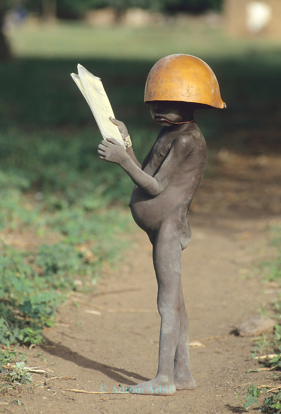 A Dinka child and feeding bowl at Thiet feeding camp in Southern Sudan. Hundreds of Dinka tribes people having had their villages bombed and burnt  by the Khartoum forces  have travelled hundreds of miles to  avoid  hunger and death.