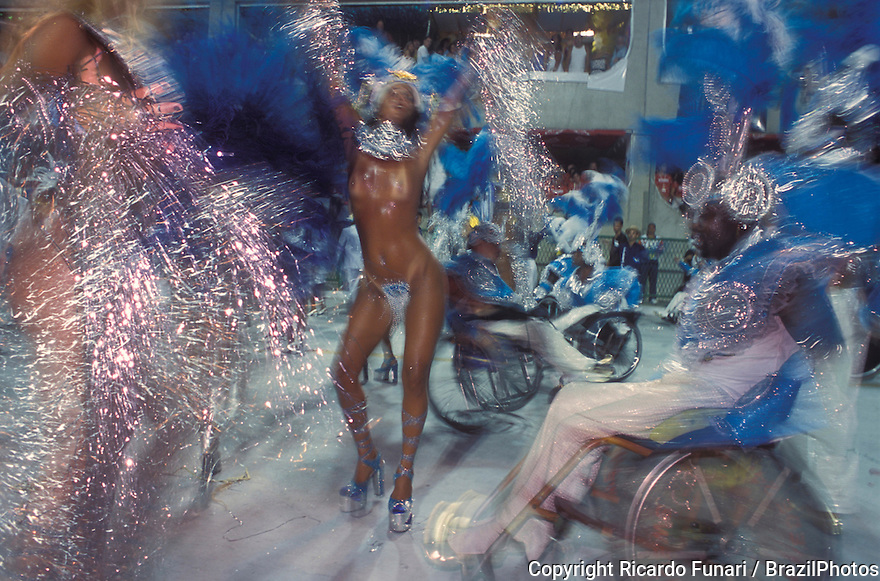 Samba schools parade, Tradicao Samba School in Carnival 2001 - sensual women dance among handicappped revelers on wheelchairs. Rio de Janeiro, Brazil.