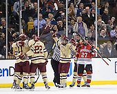 Pat Mullane (BC - 11), Paul Carey (BC - 22), Johnny Gaudreau (BC - 13), Isaac MacLeod (BC - 7) - The Boston College Eagles defeated the Northeastern University Huskies 7-1 in the opening round of the 2012 Beanpot on Monday, February 6, 2012, at TD Garden in Boston, Massachusetts.