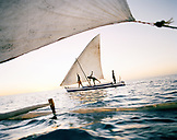MADAGASCAR, three men sailing in pirogue, Mozambique Channel, Anjajavy