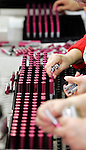 WATERTOWN, CT 12 JANUARY 2005 011205TM02<br /> workers puts cosmetic cases on a row for the finishing touches of assembly on a  production line at Watertown based Crown Risdon, a company which manufactures containers for cosmetics. Toby Morris Photo