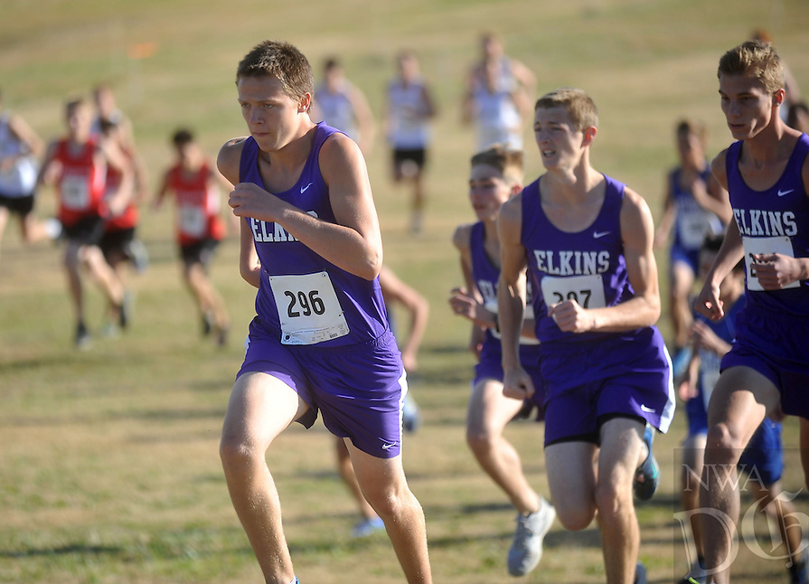 NWA Media/Michael Woods --11/08/2014-- w @NWAMICHAELW... Elkins runner Conner Daniel gets out to an early lead at the start of  the boys 3A cross country championship race Saturday afternoon at Oaklawn Park in Hot Springs.