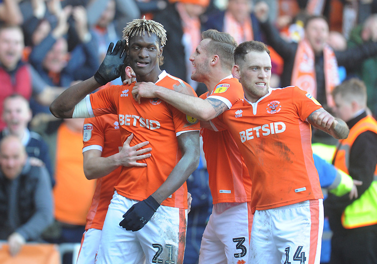 Blackpool's Armand Gnanduillet (left) celebrates scoring his side's first goal with team-mates Matthew Virtue, Nick Anderton and Harry Pritchard<br /> <br /> Photographer Kevin Barnes/CameraSport<br /> <br /> The EFL Sky Bet League One - Blackpool v Southend United - Saturday 9th March 2019 - Bloomfield Road - Blackpool<br /> <br /> World Copyright © 2019 CameraSport. All rights reserved. 43 Linden Ave. Countesthorpe. Leicester. England. LE8 5PG - Tel: +44 (0) 116 277 4147 - admin@camerasport.com - www.camerasport.com