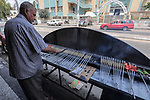 """A Palestinian vendor sells grilled meat """"Kebabs"""" in his shop in Gaza city on August 4, 2020. Photo by Mahmoud Nasser"""