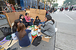 Filipina domestic workers in Hong Kong gather to share food and friendship on Chater Road on a Sunday, their only day off. <br /> <br /> There are about 370,000 foreign domestic workers in Hong Kong–about 5 percent of the population–and just under half are from the Philippines. More than 98 percent of the workers are women, most of whom leave their families behind so that they can earn money to help their families survive.