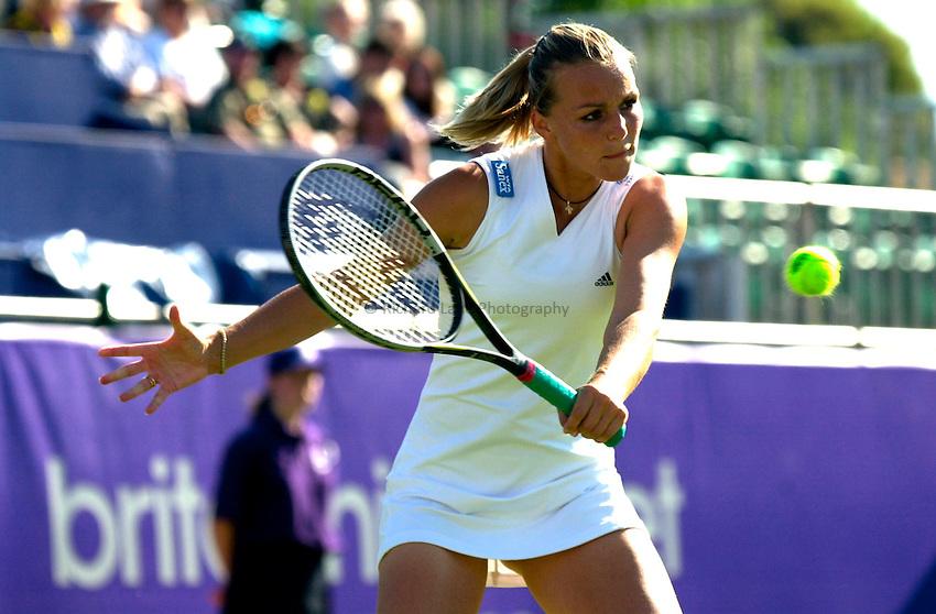 Photo. Rene Solari..19/6/01  .Eastbourne Day 2.  Frence Anne-Gaelle Sidot returns Lindsay Davenport serve....