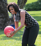 US First Lady Michelle Obama exercises on the South Lawn of the White House in Washington D.C. during an event announcing the creation of a program to promote military family wellness May 9, 2011..Copyright EML/Rockinexposures.com.