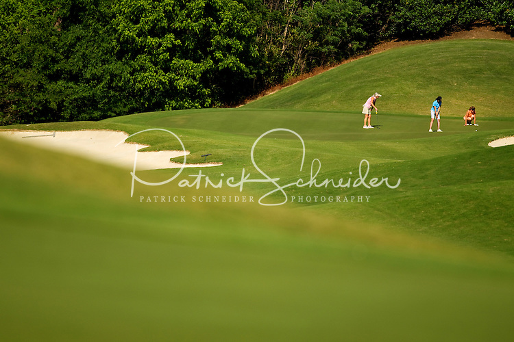 Photos of woman playing golf at the Ballantyne Hotel and Lodge in Charlotte, North Carolina. The Golf Club at Ballantyne is a championship PGA public golf course.