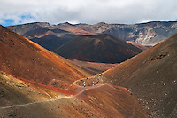 Hiking trail along the colorful orange hued lava sand at Pele's Paint Potl in the crater of HALEAKALA NATIONAL PARK on Maui in Hawaii USA