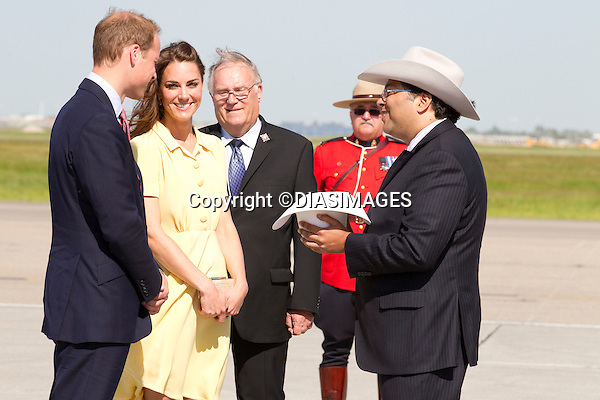 "PRINCE WILLIAM & KATE CANADA.receive hats from Calgary Mayor Naheed Nenshi during the White Hat Ceremony at Calgary Airport, Alberta_07/07/2011.Mandatory Credit Photo: ©DIASIMAGES. .**ALL FEES PAYABLE TO: ""NEWSPIX INTERNATIONAL""**..No UK Usage until 03/08/2011.IMMEDIATE CONFIRMATION OF USAGE REQUIRED:.DiasImages, 31a Chinnery Hill, Bishop's Stortford, ENGLAND CM23 3PS.Tel:+441279 324672  ; Fax: +441279656877.Mobile:  07775681153.e-mail: info@newspixinternational.co.uk"