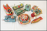 BNPS.co.uk (01202 558833)<br /> Pic: PhilYeomans/BNPS<br /> <br /> 1950's tinplate space ship's were far more Dan Dare than Star Wars in appearance.<br /> <br /> Take me to your leader - out of this world collection of rudimentary robots from the earliest days of sci-fi.<br /> <br /> The huge collection of over 500 classic sci-fi toys dates back to the 1950's and 60's and could now be worth a whopping &pound;30,000.<br /> <br /> The huge collection was started by a robot mad schoolboy in the 1950's as the Russian Sputnik satellite kick started the race for space and sparked huge interest in science fiction.<br /> <br /> The oldest items date from the late 1950's with models continuing all the way through to the 1990s with several classic favourites included.<br /> <br /> There are a number of lots related to TV classic Thunderbirds and a model of Robbie the Robot, who featured in the TV series Lost in Space and the film Forbidden Planet remains in terrific condition.