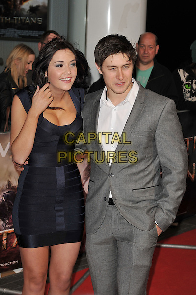 Jacqueline Jossa & Tony Discipline.'Wrath Of The Titans' European Premiere at The BFI IMAX, London, England..29th March 2012.half length blue dress grey gray suit white shirt couple cleavage hand arm in pocket .CAP/MAR.© Martin Harris/Capital Pictures.