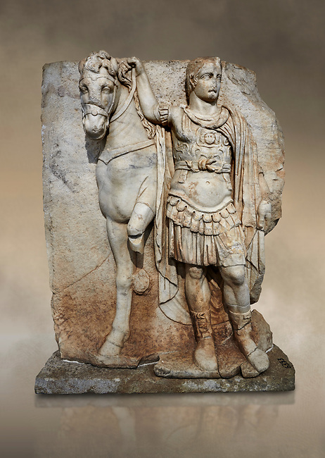 Roman Sebasteion relief sculpture of  an Imperial prince as Diokouros, Aphrodisias Museum, Aphrodisias, Turkey.  Against an art background.<br /> <br /> An imperial youth wearing a military cloak and cuirass of a commander holds the reins of hios horse. This panel is next to a Claudius panel so is probably of Britanicus or Nero the emperors son and intended successor
