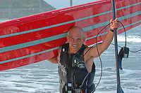 Tom Jones is jubilant upon his arrival at Ocean Beach, Saturday, November 3 2007.  Tom began paddling his 14ft paddle board along the length of the California coastline on August 4th in Crescent City California.  He plans to be the first person to paddle the entire coast of California and hopes to bring awareness to the problem of plastic pollution in our oceans along the way.  Ocean Beach was the second to last leg of the trip which was due to finish near the Mexican border in Imperial Beach on Sunday, November 4 2007.  In the end, Jones reached the Mexican border on Friday November 9, 2007.