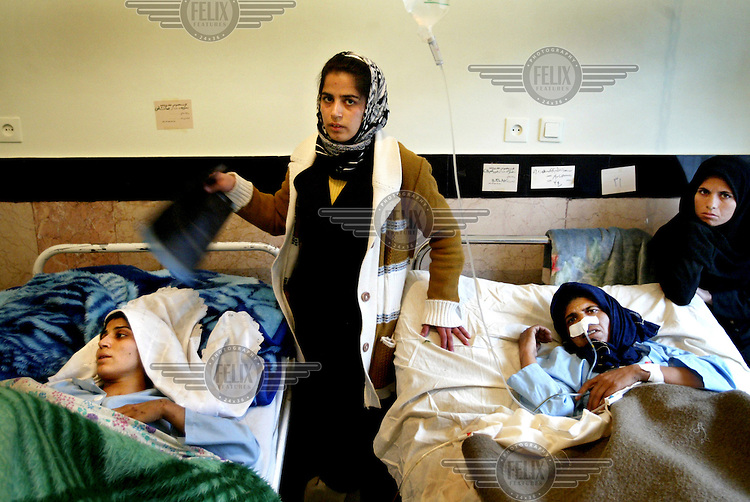 Victims of the Bam earthquake who were evacuated to a hospital in Kerman..An earthquake measuring 6.3 on the Richter scale caused widespread devastation in the ancient city of Bam and other parts of Kerman Province, leaving at least 30,000 people dead.