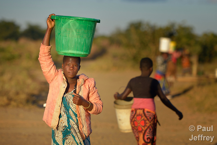 Mektie Nkuna carries water from a well to her home in Chibamu Jere, Malawi. Pregnant with her second child, Nkuna and other women in the village get support from the Maternal, Newborn and Child Health program of the Livingstonia Synod of the Church of Central Africa Presbyterian.