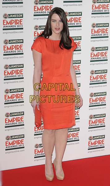 Michelle Ryan.The Jameson Empire Film Awards 2012, Grosvenor House Hotel, Park Lane, London, England..March 25th, 2012.full length orange dress clutch bag.CAP/CAN.©Can Nguyen/Capital Pictures.