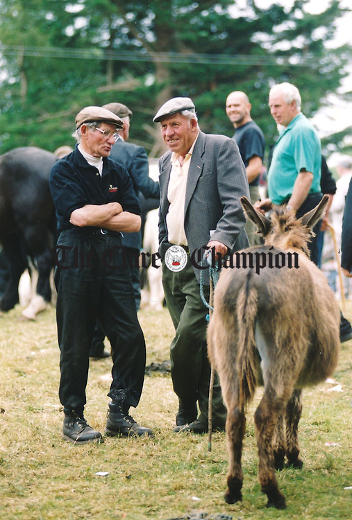 Time for a chat at the fair in Spancilhill - July 2, 1999. Photograph by John Kelly