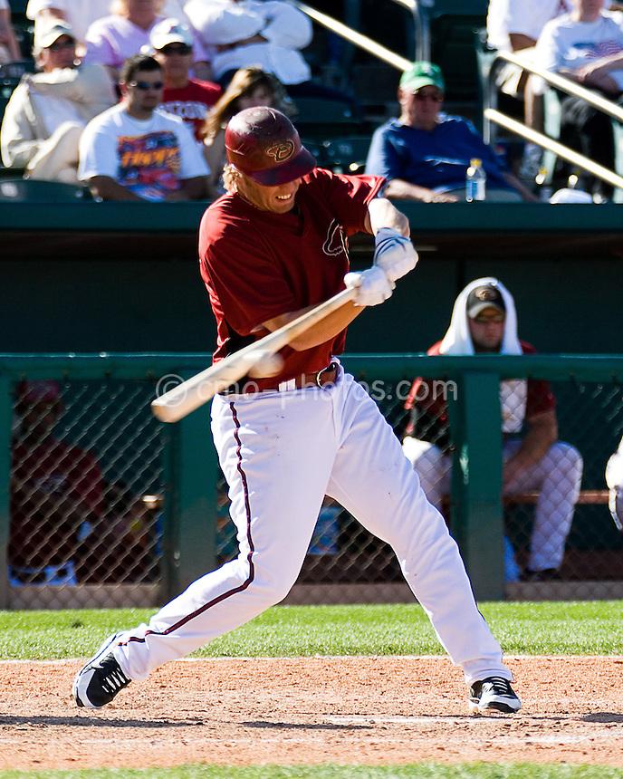Mar 22, 2008; Tucson, AZ, USA; Arizona Diamondbacks third baseman Mark Reynolds (27) hits a pitch during a game against the Colorado Rockies at Tucson Electric Park.  The Rockies beat the Diamondbacks 12-11.