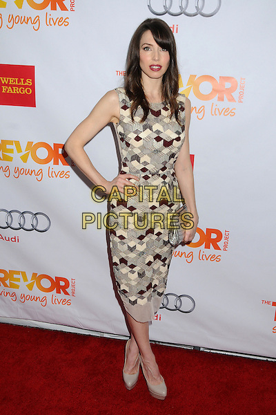 "Whitney Cummings.The Trevor Project's ""Trevor Live"" 2012 held at the Hollywood Palladium, Hollywood, California, USA..December 2nd, 2012.full length sleeveless hand on hip silver clutch bag beige pattern dress .CAP/ADM/BP.©Byron Purvis/AdMedia/Capital Pictures."