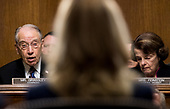 UNITED STATES - SEPTEMBER 27: Chairman Chuck Grassley, R-Iowa, left, speaks to Dr. Christine Blasey Ford during the Senate Judiciary Committee hearing on the nomination of Brett M. Kavanaugh to be an associate justice of the Supreme Court of the United States, focusing on allegations of sexual assault by Kavanaugh against Christine Blasey Ford in the early 1980s. Sen. Dianne Feinstein, D-Calif., listens to the right. (Photo By Tom Williams/CQ Roll Call/POOL)