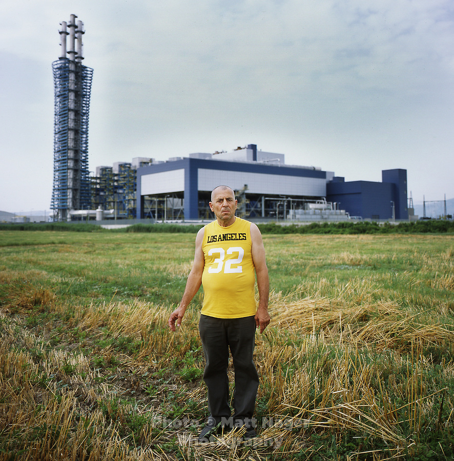 Mario Cannavacciuolo (cq), a sheep herder, stands in front of an incinerator adjacent on his abandoned land in the country side outside Acerra, Italy, Thursday, July 1, 2010. The Cannavacciuolo family has been destroyed by illegal toxic waste disposal the government sponsored garbage incinerator. His flock of sheep, of about 3000, died due to dioxin contamination. His brother, Enzo Cannavacciuolo (cq), died shortly after, and tests show his body contained levels of dioxin, purins, and PCBs 30 times the amount allowed by the World Health Organization. The Cannavacciuolo family no longer earns money off the land which has been in their family for generations...PHOTO/ MATT NAGER