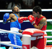 Namibia's Lazarus Shaningwa (blue) defeats Samoa's Kaisa Ioane (red) in the men's light (62kg) round of 32<br /> <br /> Photographer Chris Vaughan/CameraSport<br /> <br /> 20th Commonwealth Games - Day 3 - Saturday 26th July 2014 - Boxing - SECC - Glasgow - UK<br /> <br /> © CameraSport - 43 Linden Ave. Countesthorpe. Leicester. England. LE8 5PG - Tel: +44 (0) 116 277 4147 - admin@camerasport.com - www.camerasport.com