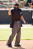 Home plate umpire Drew Maher makes a strike call during the South Atlantic League game between the Hickory Crawdads and the Kannapolis Intimidators at CMC-Northeast Stadium on April 8, 2012 in Kannapolis, North Carolina.  The Intimidators defeated the Crawdads 12-11.  (Brian Westerholt/Four Seam Images)