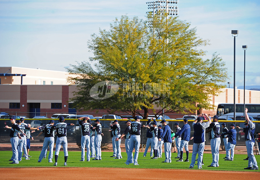 Feb. 15, 2012; Peoria, AZ, USA; Seattle Mariners players stretch during a pitchers and catchers workout at the Peoria Sports Complex.  Mandatory Credit: Mark J. Rebilas-.