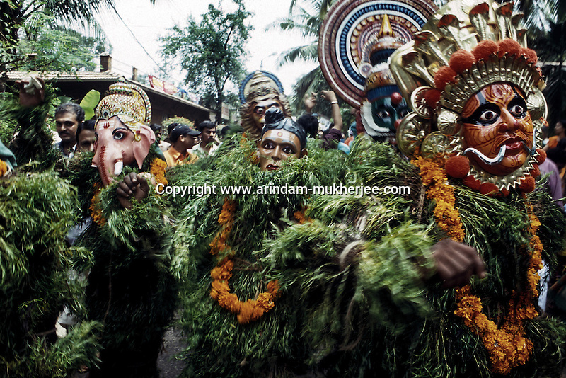 A Kummattikali procession during Onam celebration at Trishur, Kerala, india.