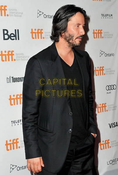 Keanu Reeves<br /> &quot;Man Of Tai Chi&quot; Premiere - 2013 Toronto International Film Festival held at Ryerson Theatre, Toronto, Ontario, Canada.<br /> September 10th, 2013<br /> half length black suit jacket top beard facial hair profile <br /> CAP/ADM/BPC<br /> &copy;Brent Perniac/AdMedia/Capital Pictures