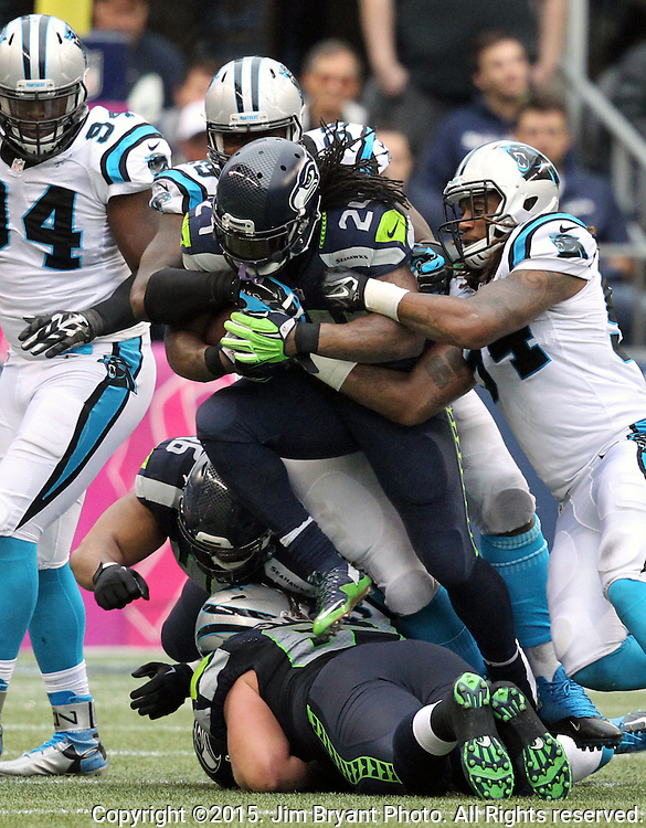 Seattle Seahawks running back Marshawn Lynch (24) carries the ball against the Carolina Panthers  at CenturyLink Field in Seattle on October 18, 2015. The Panthers came from behind with 32 seconds remaining in the 4th Quarter to beat the Seahawks 27-23.  ©2015 Jim Bryant Photography. All Rights Reserved.
