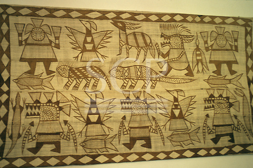 Brazil. Tribal art design painted on a woven wall hanging.