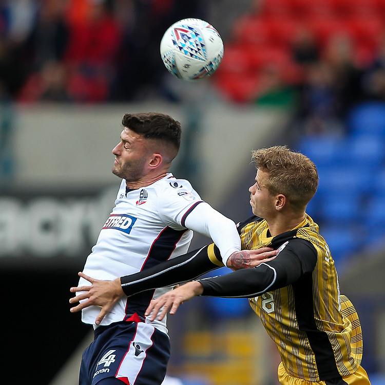 Bolton Wanderers' Gary Madine competing in the air with Sheffield Wednesday's Joost van Aken <br /> <br /> Photographer Andrew Kearns/CameraSport<br /> <br /> The EFL Sky Bet Championship - Bolton Wanderers v Sheffield Wednesday - Saturday 14th October 2017 - Macron Stadium - Bolton<br /> <br /> World Copyright &copy; 2017 CameraSport. All rights reserved. 43 Linden Ave. Countesthorpe. Leicester. England. LE8 5PG - Tel: +44 (0) 116 277 4147 - admin@camerasport.com - www.camerasport.com