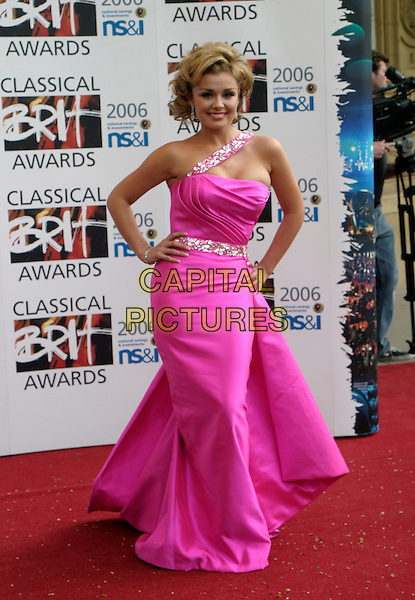 KATHERINE JENKINS.The Classical Brit Awards 2006 at The Royal Albert Hall, London, UK..May 4th, 2006.Ref: AH.full length pink satin dress one shoulder hand on hip.www.capitalpictures.com.sales@capitalpictures.com.© Capital Pictures.